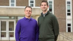 Image: two men in front of a building; Copyright: University of Delaware/ Julie Stewart