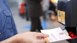Photo: Woman scans her ticket at the fair entrance