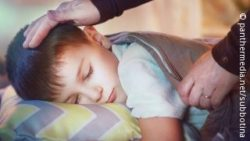Image: A boy is sleeping in his bed, a hand is covering him with a blanket; Copyright: panthermedia.net/subbotina