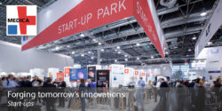 "Image: Joint stand ""MEDICA START-UP PARK"", next to it the MEDICA logo and the words ""Forging tomorrow's innovations"""