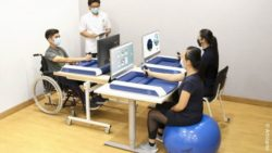 Image: people using a portable arm rehabilitation robot; Copyright: Articares
