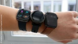 Image: A wrist with three smartwatches; Copyright: Landshut University of Applied Sciences