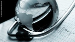 Image: The South American continent shown on a glass globe, next to it a stethoscope and an ECG printout; Copyright: panthermedia.net/sudok1