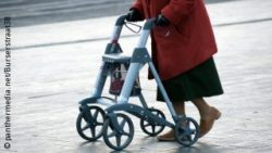 Photo: Older woman walks with a rollator