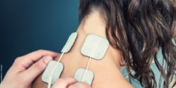 Image: Woman with electrodes in her neck; Copyright: panthermedia.net / microgen
