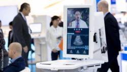 Image: A medical device with a telemedicine video conference on the screen; Copyright: Messe Düsseldorf