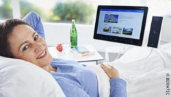 Image: Patient lying in a hospital bed with a monitor attached; Copyright: BEWATEC