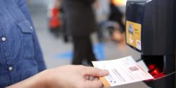 Foto: Visitor scans his ticket in the trade fair entrance area