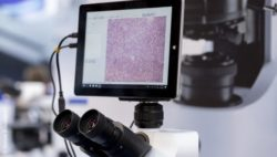 Image: microscope with monitor at MEDICA; Copyright: Messe Düsseldorf