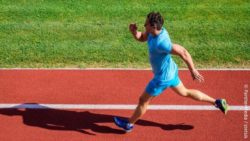 Image: man running in a lane on a sports field; Copyright: PantherMedia/stetsik