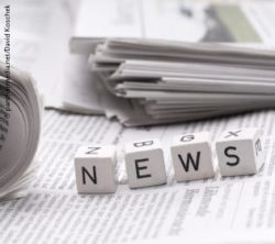 "Image: Four small wooden cubes on a newspaper spell the word ""news""; Copyright: panthermedia.net/David Koschek"
