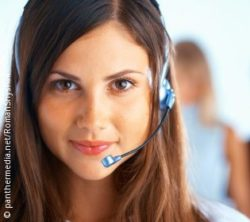Photo: Woman with headset; copyright: panthermedia.net/RomanShyshak