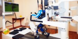 Image: Boy with robotic gait trainer on treadmill; Copyright: panthermedia.net/olesiabilkei