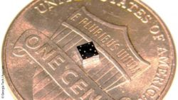 Image: A black, small chip on top of a coin; Copyright: Georgia Tech/Ayazi Lab