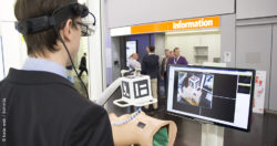 Image: Person wearing Augmented Reality glasses looking at a monitor; Copyright: beta-web / Schmitz