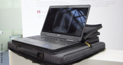 Image: Open laptop on a large laptop bag with X-ray image on the desktop; Copyright: beta-web / Schmitz