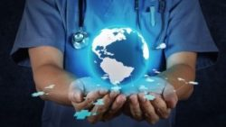 Image: A physician is holding a globe in his hands; Copyright: panthermedia.net/everythingposs