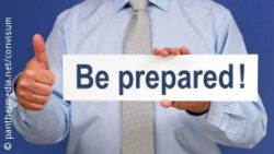 Photo: Man holding a sign reading: Be prepared!