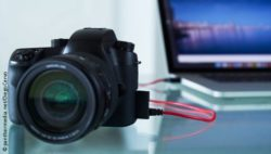 Image: Camera connected to a laptop; Copyright: panthermedia.net/Diego Cervo