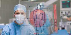 Image: Surgeon is looking at the computer-generated diagram of a human that floats in front of him; Copyright: panthermedia.net/Wavebreakmediamicro