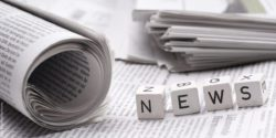 "Photo: Four wooden cubes with letters on them form the word ""news"""