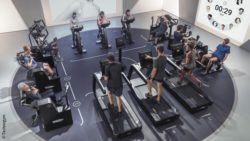 Image: View from above into a gym where many people train with different machines; Copyright: Technogym