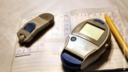 Image: POCT-device and patient files; Copyright: panthermedia.net/gabriella