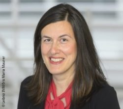 Image: Smiling woman with long dark hair and dark blazer - Prof. Aránzazu del Campo; Copyright: Leibniz INM/Iris Maria Maurer